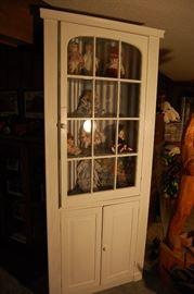 Antique corner cabinet, dolls