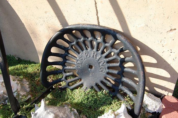 Deering cast iron tractor seat