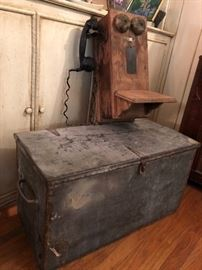 Cool old tin tool chest and old wooden wall mount telephone