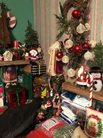 A room full of Christmas holiday decorations and decor.