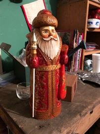 Hand carved and decorated wooden Santa from Russia.  Signed