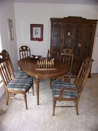 One dining set, table and 6 chairs, large hutch to match