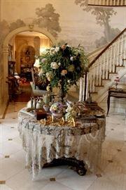 Floral arrangement and lace cover