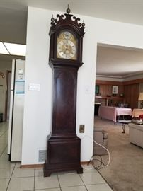A BEAUTIFUL OLD GRANDFATHER CLOCK RINGS ON A BELL. IT IS A BEAUTY!