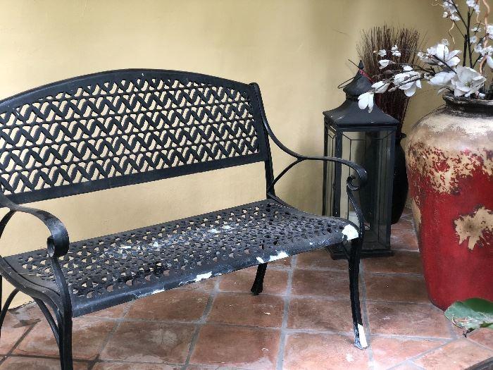 Garden bench with yard art