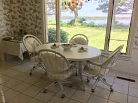 White dinette set (table with one leaf & four swivel chairs).