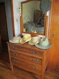 DRESSER WITH MIRROR AND MEN'S HATS