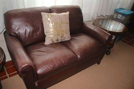 Leather Love Seat, Accent Pillow, Round Glass and Wood Side Table