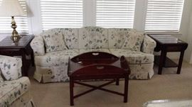 Matching cloth sofa and love seat.  Matching mahogany coffee table and 2 end table.  Brass table lamp.