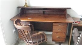 Barrister's desk.  Swivel chair with attached leather seat cushion.
