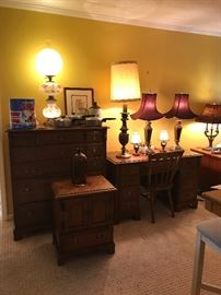 """Brown Chest of Drawers, Matching Night Stand & Desk With Chair, """"Gone With The Wind"""" lamp, """"Houston Oilers"""" Trash Can, """"Magnite"""" Old pots, Connie King Signed Lithograph & Lamps, Western Stoneware Crock, Owave Illinois Glass Co Brown Jug"""