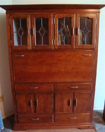 Bookkeepers Desk by Pennsylvania House.  Leaded Glass Doors, Drop front Desk.  Original price was 4500.00.  Owners paid 1979.50