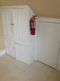 painted white wood doors and built in