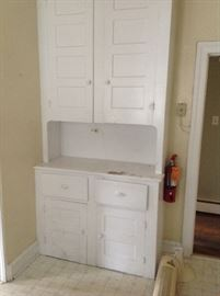 amazing built in storage unit. So cute for your kitchen, laundry room or pantry.