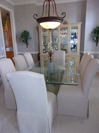 Lane beveled glass dining table with 8 upholstered Lane Venture chairs.