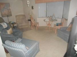notice leather recliner (there are two!) Matching blue ribbon design chairs.(also two).