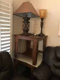 Three end tables with tile inserts .
