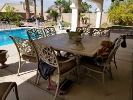 Beautiful stone top patio table + 8 chairs