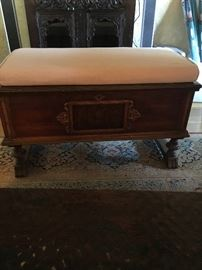 Antique carved cedar hope chest with cushion