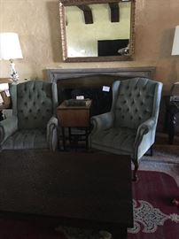 Turner Mfg Antique mirror, pair of tufted Queen Anne chairs, antique industrial typewriter sidetable, Antique pair of ceramic lamps with wood etchings.