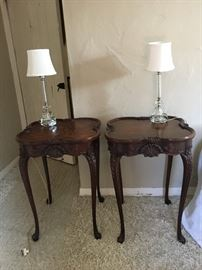 Antique French mahogany carved side/end tables nightstands. Antique crystal lamps with etching in glass and silk shades.