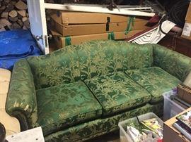 green damask upholstered sofa