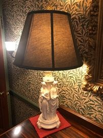 one of a pair of antique parian lamps