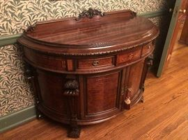 Antique demi-lune commode with inlaid decoration and carvings