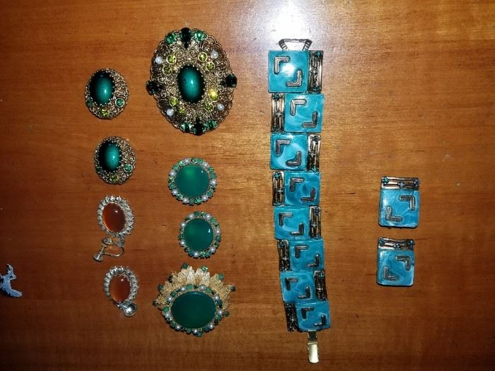 The earrings and Brooch in the second row from the left on the bottom is from Jewelry by Robert. A fine set. The Bracelet on the right and the earrings are another fabulous find. Bring your money!
