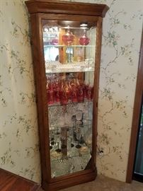 A beautiful Howard Miller Corner Curio Cabinet.