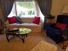 Excellent Neutral toned Sofa. Wrought Iron Glass Oval Coffee Table. Navy Blue Arm Chair. Several Wrought Iron Glass Accent Tables. Curtains and Shears are also for sale. Prayer Plant.