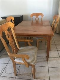 Wooden table with five chairs