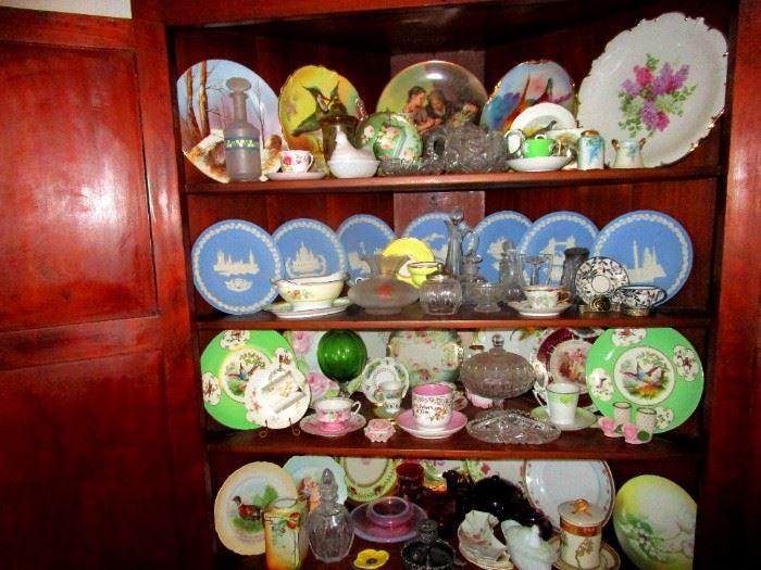 Corner cabinet full of collectible ceramics: Limoges , Wedgwood, De Havilland an more