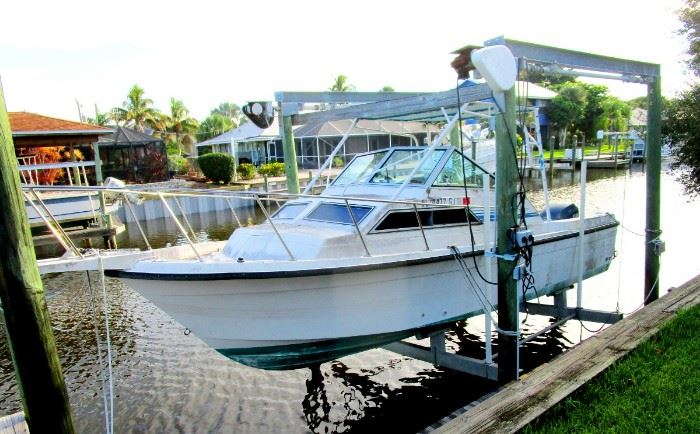 27 ft  Foot cabin cruiser with two bunks, shower and toilet for sale at bargain price..