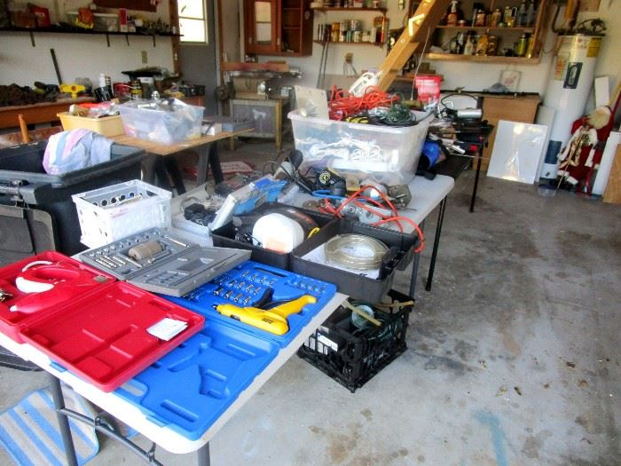 Power tools, drills, sanders, ratchet sets, bins of electrical extension cords