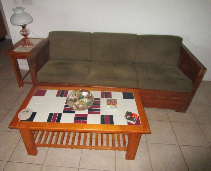 Solid wood sofa and ceramic tile topped coffee table