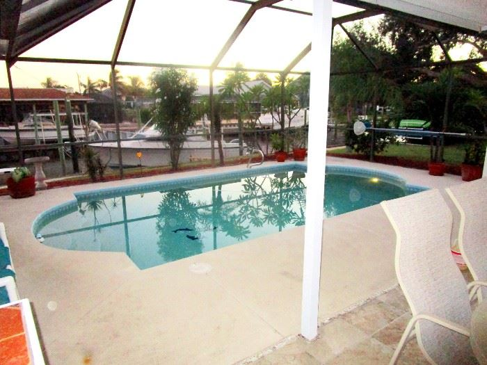 This canal front pool home with private dock just 4 miles from Sebastian Inlet is also for sale