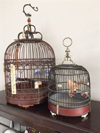 Vintage and/or antique Chinese wooden bird cages with amazing original accessories.