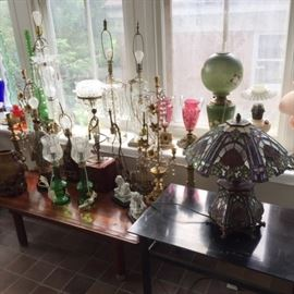 A few of the antique & vintage  lamps in our large lamp department! Glass lamps, porcelain lamps, wooden lamps, brass lamps, stained glass lamps, and so on.