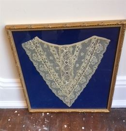 Lovely piece of needle lace (?) in a gilt wood frame.