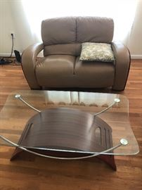 Leather furniture and glass top coffee table