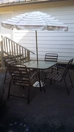 Table and 4 chairs, umbrella -$55.00