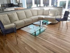 Natuzzi leather sectional and Ligne Roset chairs