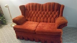 NICE LOVE SEAT  A LITTLE DARKER IN PERSON HAS A MATCHING SOFA