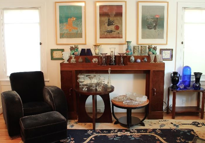 Deco mantel, club chair with ottoman, artwork by Lai Shek