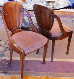 two of four carved dining chairs