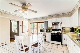 Entire kitchen. Table, chairs, small appliances, dishes, glasses, tableware, serving ware, linens.
