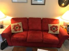 Red upholstered couch