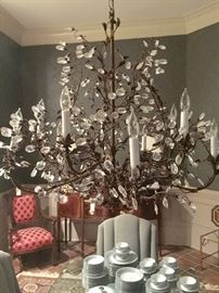 Bronze/gold high end 8 arm chandelier.   Multi-faceted pear shaped crystals.  Approx 37 x 38.  Gorgeous!
