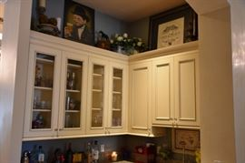 Cabinets are for sale.  Items on top shelf not for sale. sorry.